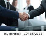 partners concluding deal and... | Shutterstock . vector #1043572333