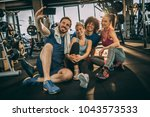 friends having fun at the gym.... | Shutterstock . vector #1043573533