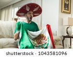 mexican fan watching a soccer... | Shutterstock . vector #1043581096