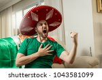 mexican fan watching a soccer... | Shutterstock . vector #1043581099
