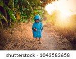 asian baby boy in a blue jacket ...   Shutterstock . vector #1043583658