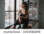 young woman in her pajamas... | Shutterstock . vector #1043586898