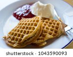 a waffle with jam and sour... | Shutterstock . vector #1043590093