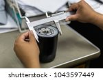 measurement of workpiece oil... | Shutterstock . vector #1043597449