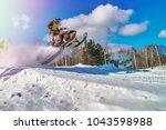 Sport Yellow Snowmobile Jump....