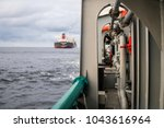 Small photo of View from deck of AHTS ocean tug. Tanker vessel on background. Dp posioning vessels. Oil and gas industry