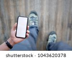 man on walking and holding... | Shutterstock . vector #1043620378