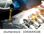 refueling and pouring oil... | Shutterstock . vector #1043644108