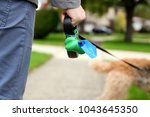 man  picking up   cleaning up... | Shutterstock . vector #1043645350