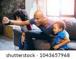 happy african american family...   Shutterstock . vector #1043657968