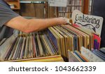 man going through used records... | Shutterstock . vector #1043662339