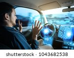 young man riding autonomous car.   Shutterstock . vector #1043682538