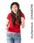 Beautiful Asian woman wearing headphones & listening to the music. - stock photo