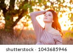 redhead girl in style clothes... | Shutterstock . vector #1043685946