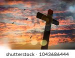 cross on blurry sunset... | Shutterstock . vector #1043686444