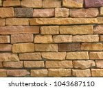 brown rock texture stone wall... | Shutterstock . vector #1043687110