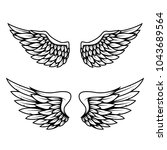 set of wings isolated on white... | Shutterstock .eps vector #1043689564