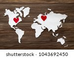 red felt hearts and world map... | Shutterstock . vector #1043692450
