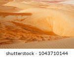 abstract patterns in the dunes... | Shutterstock . vector #1043710144