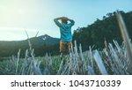 asian men travel nature. travel ... | Shutterstock . vector #1043710339