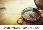 old vintage retro compass on... | Shutterstock . vector #1043718520