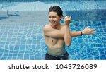 handsome asian wet sexy... | Shutterstock . vector #1043726089