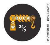 tow truck icon. wrecker logotip.... | Shutterstock .eps vector #1043735344