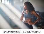 fit athletic african american... | Shutterstock . vector #1043740840