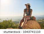 fit female hiker resting on top ... | Shutterstock . vector #1043741110