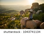 fit female hiker sitting on... | Shutterstock . vector #1043741134