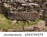 """""""the old farmhouse"""" sign within ... 