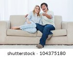 a young couple are sitting down ... | Shutterstock . vector #104375180