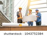 engineer or foreman talking the ... | Shutterstock . vector #1043752384