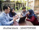 small creative team of south... | Shutterstock . vector #1043759500