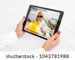woman watching online video... | Shutterstock . vector #1043781988