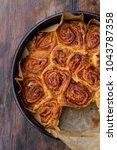 sweet rolls with cinnamon and... | Shutterstock . vector #1043787358