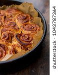 sweet rolls with cinnamon and... | Shutterstock . vector #1043787364