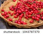 red rose hips on basket | Shutterstock . vector #1043787370