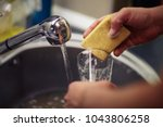 close up washing dishes. male... | Shutterstock . vector #1043806258