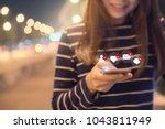 happy woman hands using mobile... | Shutterstock . vector #1043811949