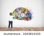 rear view of a cute little boy... | Shutterstock . vector #1043814103