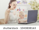 young mother and baby using...   Shutterstock . vector #1043838163