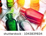 Small photo of small colorful plastic bottles of shampoo, liquid soap or lotion for traveling, hotel amenities kit