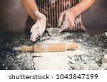 Small photo of Man preparing bread dough on table, Making bread, retro style imagery.