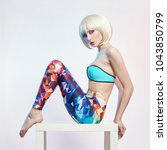 blonde in the blue leotard and... | Shutterstock . vector #1043850799