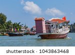 Pink And White Tourist Boat On...