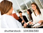 Woman doing check-in at a hotel and paying by credit cad - stock photo