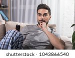 portrait of concentrated... | Shutterstock . vector #1043866540