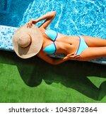 woman in straw hat relaxing by...   Shutterstock . vector #1043872864