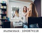 smiling female esthetician... | Shutterstock . vector #1043874118